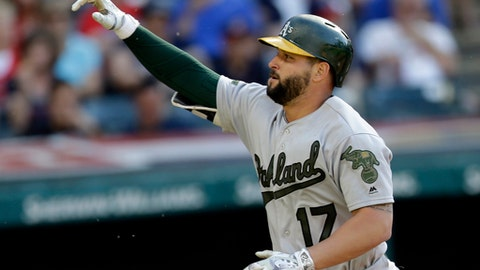 Oakland Athletics' Yonder Alonso points after hitting a solo home run off Cleveland Indians starting pitcher Carlos Carrasco in the seventh inning of a baseball game, Monday, May 29, 2017, in Cleveland. (AP Photo/Tony Dejak)