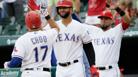 Texas Rangers Shin-Soo Choo (17), of South Korea, celebrates his solo home run with teammate Nomar Mazara during the first inning of a baseball game against the Tampa Bay Rays in Arlington, Texas, Tuesday, May 30, 2017. (AP Photo/LM Otero)