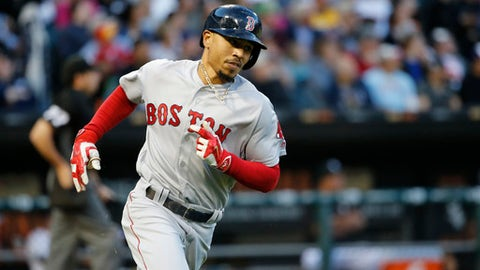Boston Red Sox's Mookie Betts rounds the bases after hitting a home run off Chicago White Sox starting pitcher Jose Quintana during the second inning of a baseball game Tuesday, May 30, 2017, in Chicago. (AP Photo/Charles Rex Arbogast)