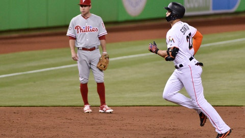 Miami Marlins' Giancarlo Stanton, left, runs the bases after hitting a home run during the third inning of a baseball game against the Philadelphia Phillies, Tuesday May 30, 2017, in Miami. (AP Photo/Gaston De Cardenas)