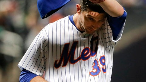 New York Mets pitcher Jerry Blevins (39) walks off the field at the end of the seventh inning of a baseball game against the Milwaukee Brewers, Tuesday, May 30, 2017, in New York. (AP Photo/Julie Jacobson)