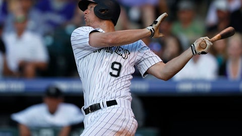 Colorado Rockies' DJ LeMahieu follows the flight of his single to drive in two runs off Seattle Mariners starting pitcher Ariel Miranda in the fifth inning of an interleague baseball game Tuesday, May 30, 2017, in Denver. Seattle won 10-4. (AP Photo/David Zalubowski)