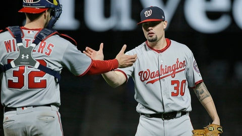 Washington Nationals relief pitcher Koda Glover, right, is greeted by catcher Matt Wieters, left, at the end of a baseball game Tuesday, May 30, 2017, in San Francisco. Washington won the game 6-3. (AP Photo/Eric Risberg)