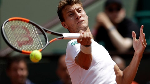 Argentina's Renzo Olivo plays a shot against France's Jo-Wilfried Tsonga during their first round match of the French Open tennis tournament at the Roland Garros stadium, in Paris, France. Wednesday, May 31, 2017. (AP Photo/Petr David Josek)