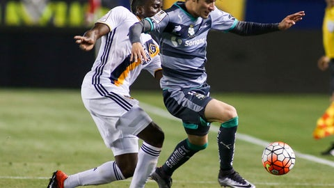 FILE - In this Wednesday, Feb. 24, 2016, file photograph, Santos Laguna midfielder Jorge Flores Villafana, right, battles for the ball during the first half of a CONCACAF Champions League quarterfinal against Los Angeles Galaxy in Carson, Calif. U.S. midfielder Jorge Villafana never grows weary of retelling his story. It's a captivating tale of how he went from playing street soccer to missing church for a nationally televised tryout to earning a spot and launching a career that's landed him on the national team.(AP Photo/Ringo H.W. Chiu, File)