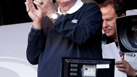"""FILE - This Friday, June 1, 2012 file photo, Chicago White Sox broadcaster Ken Harrelson cheers for the White Sox before a baseball game against the Seattle Mariners in Chicago. White Sox broadcaster Ken """"Hawk"""" Harrelson says he will retire after working 20 games next year in his 34th season in the booth. Harrelson, a colorful character known for sayings like """"You Can Put It On The Board"""" when the White Sox hit a home run, will work primarily Sunday home games in 2018.(AP Photo/Nam Y. Huh, File)"""