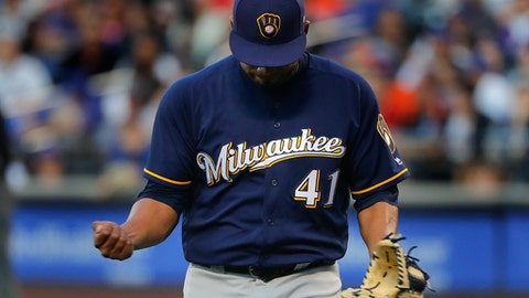 Milwaukee Brewers pitcher Junior Guerra (41) pumps his fist as he walks off the field after striking out New York Mets' Lucas Duda to end the first inning of a baseball game, Wednesday, May 31, 2017, in New York. (AP Photo/Julie Jacobson)