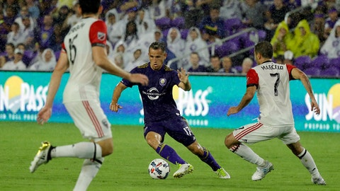 Orlando City's Luis Gil (17) moves the ball between D.C. United's Steve Birnbaum, left, and Marcelo Sarvas (7) during the first half of an MLS soccer game, Wednesday, May 31, 2017, in Orlando, Fla. (AP Photo/John Raoux)