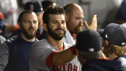 Boston Red Sox's Mitch Moreland celebrates in the dugout after scoring against the Chicago White Sox during the sixth inning of a baseball game in Chicago on Wednesday, May 31, 2017. (AP Photo/Matt Marton)
