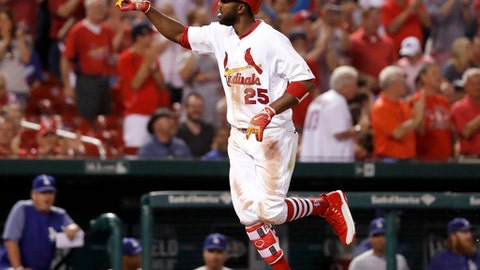 St. Louis Cardinals' Dexter Fowler celebrates as he rounds the bases after hitting a solo home run during the eighth inning of a baseball game against the Los Angeles Dodgers on Wednesday, May 31, 2017, in St. Louis. The Cardinals won 2-1. (AP Photo/Jeff Roberson)