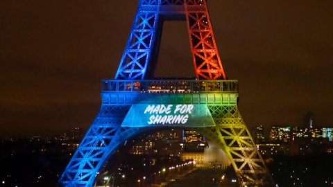 "FILE - In this Feb. 3, 2017 file photo, the Eiffel Tower is lit up with colors during the launch of its campaign as candidate for the 2024 Olympic summer games in Paris. The Paris bid team is fine with an unprecedented double vote on Olympic hosts, as long as the French capital is awarded the 2024 Games. With Paris and Los Angeles the remaining 2024 bidders, IOC President Thomas Bach has raised the prospect of one city getting 2024 and the other taking 2028. ""We can't accept '28,"" Paris bid co-chairman Tony Estanguet said during a visit to London on Tuesday, March 21, 2017. ""It's not possible."" (AP Photo/Francois Mori, file)"