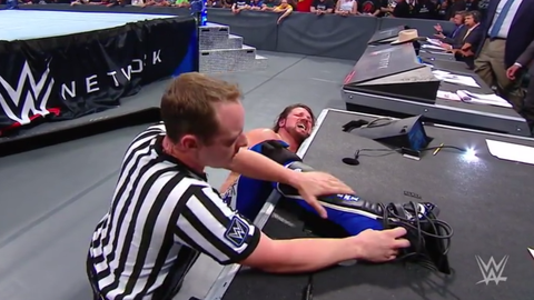 Kevin Owens defeated AJ Styles by count out to retain the United States Championship