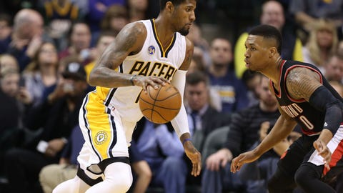 Feb 28, 2016; Indianapolis, IN, USA; Indiana Pacers forward Paul George (13) drives to the basket against Portland Trail Blazers guard Damian Lillard (0) at Bankers Life Fieldhouse. Portland defeated Indiana 111-102. Mandatory Credit: Brian Spurlock-USA TODAY Sports
