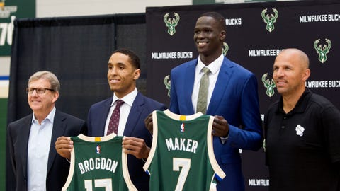Jun 24, 2016; Milwaukee, WI, USA; Bucks general manager John Hammond (L), second round pick Malcolm Brogdon (13), first round pick Thon Maker (7), and head coach Jason Kidd (R) pose for a photo during an introduction press conference at the Milwaukee Bucks training facility. Mandatory Credit: Sam Caravana- Milwaukee Journal Sentinel via USA TODAY Sports