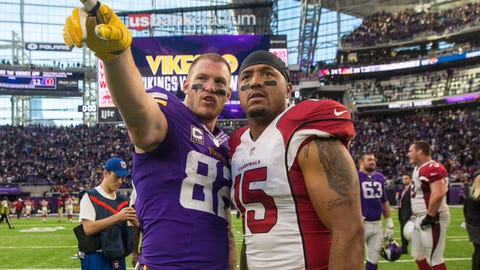 Nov 20, 2016; Minneapolis, MN, USA; Minnesota Vikings tight end Kyle Rudolph (82) talks with Arizona Cardinals wide receiver Michael Floyd (15) following the game at U.S. Bank Stadium. The Vikings defeated the Cardinals 30-24. Mandatory Credit: Brace Hemmelgarn-USA TODAY Sports