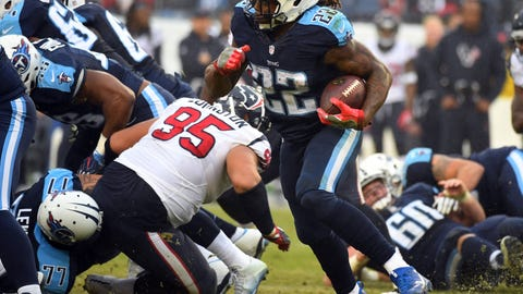 Jan 1, 2017; Nashville, TN, USA; Tennessee Titans running back Derrick Henry (22) runs for a first down during the second half against the Houston Texans at Nissan Stadium. The Titans won 24-17. Mandatory Credit: Christopher Hanewinckel-USA TODAY Sports