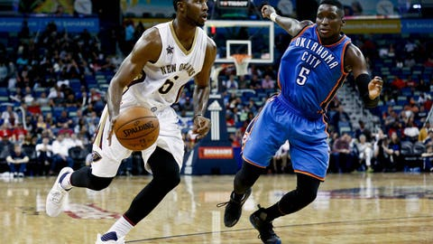 Jan 25, 2017; New Orleans, LA, USA; New Orleans Pelicans guard E'Twaun Moore (55) drives past Oklahoma City Thunder guard Victor Oladipo (5) during the second half of a game at the Smoothie King Center. The Thunder defeated the Pelicans 114-105. Mandatory Credit: Derick E. Hingle-USA TODAY Sports