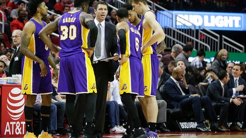 Mar 15, 2017; Houston, TX, USA; Los Angeles Lakers head coach Luke Walton talks to his team during Houston Rockets timeout in the second quarter at Toyota Center. Mandatory Credit: Thomas B. Shea-USA TODAY Sports