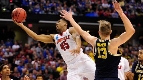 Mar 19, 2017; Indianapolis, IN, USA; Louisville Cardinals guard Donovan Mitchell (45) shoots against Michigan Wolverines forward Moritz Wagner (13) during the second half in the second round of the 2017 NCAA Tournament at Bankers Life Fieldhouse. Mandatory Credit: Thomas Joseph-USA TODAY Sports