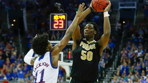 Mar 23, 2017; Kansas City, MO, USA; Purdue Boilermakers forward Caleb Swanigan (50) shoots as Kansas Jayhawks guard Josh Jackson (11) defends during the second half in the semifinals of the midwest Regional of the 2017 NCAA Tournament at Sprint Center. Mandatory Credit: Jay Biggerstaff-USA TODAY Sports
