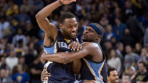 January 6, 2017; Oakland, CA, USA; Memphis Grizzlies guard Tony Allen (9, left) celebrates with forward Zach Randolph (50, right) during overtime against the Golden State Warriors at Oracle Arena. The Grizzlies defeated the Warriors 128-119. Mandatory Credit: Kyle Terada-USA TODAY Sports