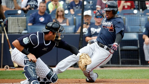 Mar 12, 2017; Tampa, FL, USA; Atlanta Braves center fielder Ronald Acuna (89) slides home to score a run as New York Yankees catcher Austin Romine (27) attempted to tag him out during the first inning at George M. Steinbrenner Field. Mandatory Credit: Kim Klement-USA TODAY Sports