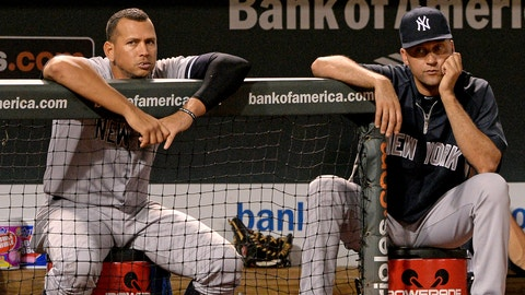 BALTIMORE, MD - SEPTEMBER 11: Alex Rodriguez #13 (L) and Derek Jeter #2 of the New York Yankees look on against the Baltimore Orioles in the ninth inning at Oriole Park at Camden Yards on September 11, 2013 in Baltimore, Maryland.(Photo by Patrick Smith/Getty Images)