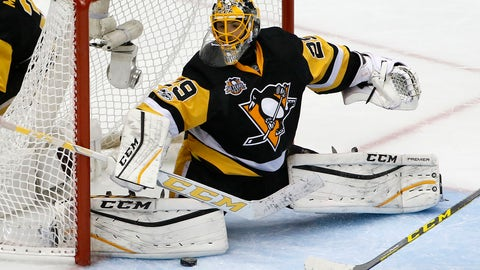 Pittsburgh Penguins goalie Marc-Andre Fleury (29) stops a shot during the first period of Game 4 in an NHL Stanley Cup Eastern Conference semifinal hockey game against the Washington Capitals in Pittsburgh, Wednesday, May 3, 2017. The Penguins won 3-2. (AP Photo/Gene J. Puskar)