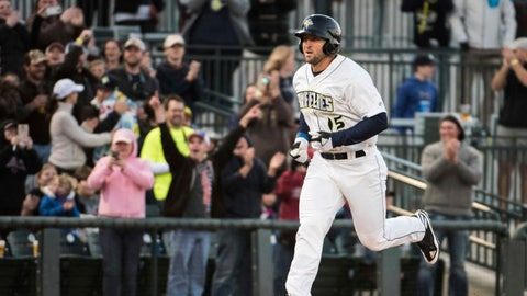 Columbia Fireflies' Tim Tebow approaches home plate after hitting a home run in his first at-bat for the team, in a minor league baseball game against the Augusta GreenJackets on Thursday, April 6, 2017, in Columbia, S.C. (AP Photo/Sean Rayford)