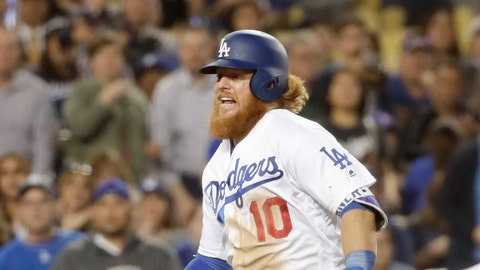 Los Angeles Dodgers' Justin Turner limps down the baseline during seventh inning of a baseball game against the Miami Marlins in Los Angeles, Thursday, May 18, 2017. Turner limped off the field and left the game. (AP Photo/Chris Carlson)