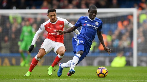 LONDON, ENGLAND - FEBRUARY 04:  Ngolo Kante of Chelsea runs with the ball under pressure from Alexis Sanchez of Arsenal during the Premier League match between Chelsea and Arsenal at Stamford Bridge on February 4, 2017 in London, England.  (Photo by Mike Hewitt/Getty Images)