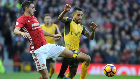 MANCHESTER, ENGLAND - NOVEMBER 19:  Theo Walcott of Arsenal takes on Matteo Darmian of Man United during the Premier League match between Manchester United and Arsenal at Old Trafford on November 19, 2016 in Manchester, England.  (Photo by Stuart MacFarlane/Arsenal FC via Getty Images)