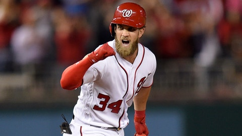 Washington Nationals' Bryce Harper pumps his fist as he stands on second with a double during the ninth inning of the team's baseball game against the Baltimore Orioles, Wednesday, May 10, 2017, in Washington. The Nationals won 7-6. (AP Photo/Nick Wass)