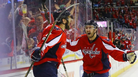 WASHINGTON, DC - MAY 06:  Alex Ovechkin #8 of the Washington Capitals scores at 7:47 of the third period against the Pittsburgh Penguins and is embraced by Kevin Shattenkirk #22 in Game Five of the Eastern Conference Second Round during the 2017 NHL Stanley Cup Playoffs at the Verizon Center on May 6, 2017 in Washington, DC.  (Photo by Bruce Bennett/Getty Images)