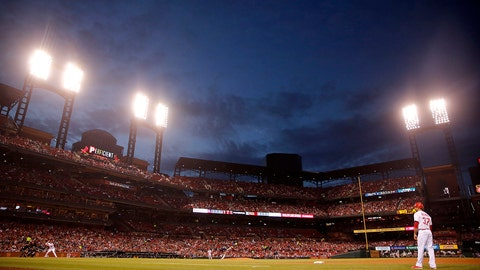 St. Louis Cardinals' Stephen Piscotty bats s dusk falls over Busch Stadium during the fourth inning of a baseball game against the Milwaukee Brewers Tuesday, May 2, 2017, in St. Louis. (AP Photo/Jeff Roberson)