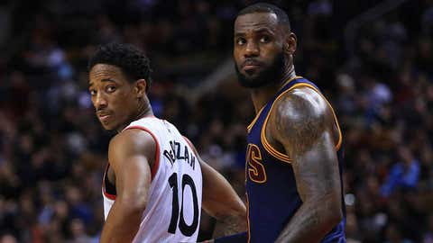 TORONTO, ON - DECEMBER 05:  Lebron James #23 of the Cleveland Cavaliers and DeMar DeRozan #10 of the Toronto Raptors look on during the second half of an NBA game at Air Canada Centre on December 5, 2016 in Toronto, Canada.  NOTE TO USER: User expressly acknowledges and agrees that, by downloading and or using this photograph, User is consenting to the terms and conditions of the Getty Images License Agreement.  (Photo by Vaughn Ridley/Getty Images)