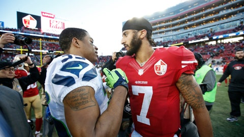 SANTA CLARA, CA - JANUARY 1: Kelcie McCray #33 of the Seattle Seahawks and Colin Kaepernick #7 of the San Francisco 49ers talk on the field following the game at Levi Stadium on January 1, 2017 in Santa Clara, California. The Seahawks defeated the 49ers 25-23. (Photo by Michael Zagaris/San Francisco 49ers/Getty Images)
