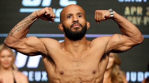 Demetrious Johnson poses on the scale during a weigh-in for UFC 197, Friday, April 22, 2016, in Las Vegas. Johnson is scheduled to fight Henry Cejudo in a flyweight title fight Saturday in Las Vegas. (AP Photo/John Locher)