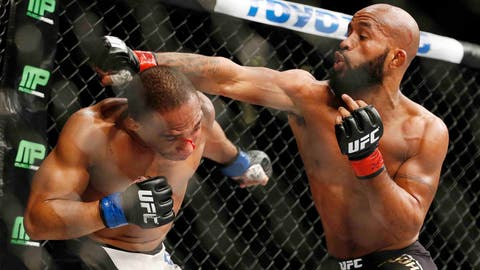 CORRECTS NAME TO DEMETRIOUS FROM DEMETRIUS - Demetrious Johnson, right, fights John Dodson during their flyweight title mixed martial arts bout at UFC 191, Saturday, Sept. 5, 2015, in Las Vegas. (AP Photo/John Locher)