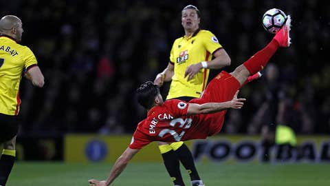 Liverpool's German midfielder Emre Can connects with this overhead kick to open the scoring in the English Premier League football match between Watford and Liverpool at Vicarage Road Stadium in Watford, north of London on May 1, 2017. / AFP PHOTO / Adrian DENNIS / RESTRICTED TO EDITORIAL USE. No use with unauthorized audio, video, data, fixture lists, club/league logos or 'live' services. Online in-match use limited to 75 images, no video emulation. No use in betting, games or single club/league/player publications.  /         (Photo credit should read ADRIAN DENNIS/AFP/Getty Images)