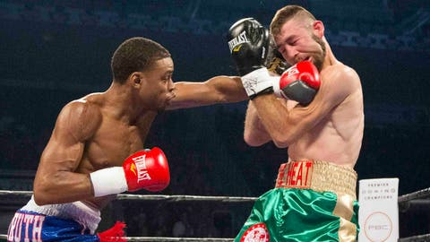Errol Spence Jr. connects to the jaw of Chris Van Heerden during their WBC welterweight boxing match Friday, Sept. 11, 2015, in Toronto. (Peter Power/The Canadian Press via AP) MANDATORY CREDIT
