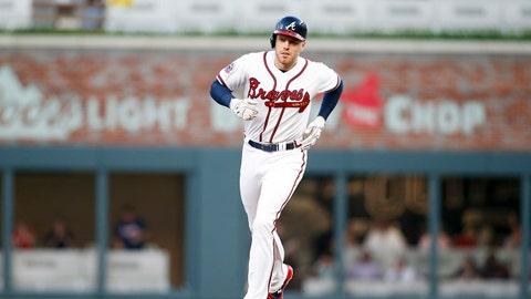 May 2, 2017; Atlanta, GA, USA; Atlanta Braves first baseman Freddie Freeman (5) rounds second on a home run against the New York Mets in the first inning at SunTrust Park. Mandatory Credit: Brett Davis-USA TODAY Sports
