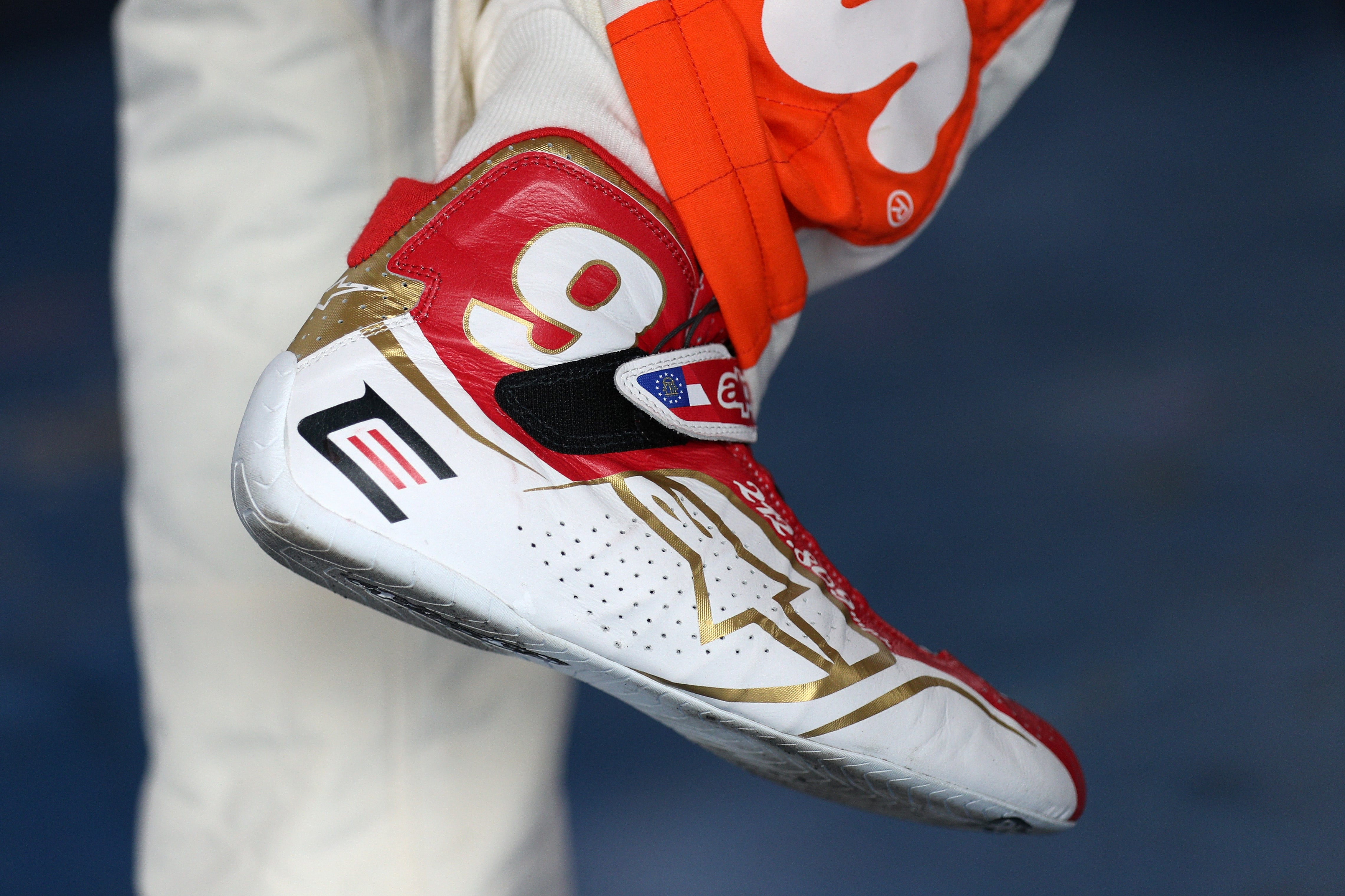 TALLADEGA, AL - MAY 05: A detailed view of shoes worn by Chase Elliott, driver of the #24 Hooters Chevrolet, commemorating his father Bill Elliott's 212.809 qualifying lap time, during practice for the Monster Energy NASCAR Cup Series GEICO 500 at Talladega Superspeedway on May 5, 2017 in Talladega, Alabama. (Photo by Chris Graythen/Getty Images)