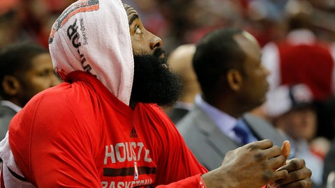 HOUSTON, TX - APRIL 05:  James Harden #13 of the Houston Rockets watches from the bench in the first half against the Denver Nuggets at Toyota Center on April 5, 2017 in Houston, Texas.  NOTE TO USER: User expressly acknowledges and agrees that, by downloading and or using this photograph, User is consenting to the terms and conditions of the Getty Images License Agreement.  (Photo by Tim Warner/Getty Images)