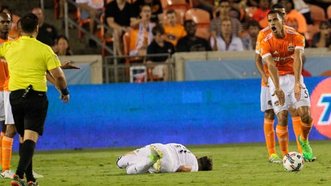 Houston Dynamo midfielder Juan Cabezas (5) argues with referee Ricardo Salazar that he did not foul Real Salt Lake midfielder Albert Rusnak (11) during the second half of an MLS soccer match Wednesday, May 31, 2017, in Houston. Cabezas received a yellow card on the play. (Yi-Chin Lee/Houston Chronicle via AP)