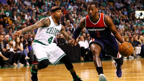 BOSTON, MA - APRIL 30: John Wall #2 of the Washington Wizards drives against Isaiah Thomas #4 of the Boston Celtics during the first quarter of Game One of the Eastern Conference Semifinals at TD Garden on April 30, 2017 in Boston, Massachusetts. NOTE TO USER: User expressly acknowledges and agrees that, by downloading and or using this Photograph, user is consenting to the terms and conditions of the Getty Images License Agreement. (Photo by Maddie Meyer/Getty Images)