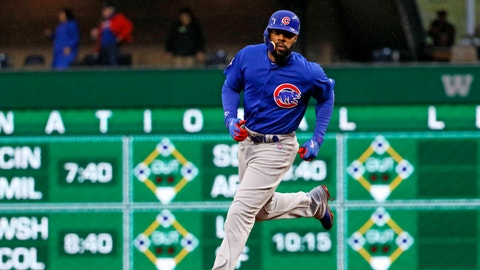 Chicago Cubs' Jason Heyward rounds second base after hitting a three-run home run off Pittsburgh Pirates starting pitcher Chad Kuhl in the first inning of a baseball game in Pittsburgh, Monday, April 24, 2017. (AP Photo/Gene J. Puskar)