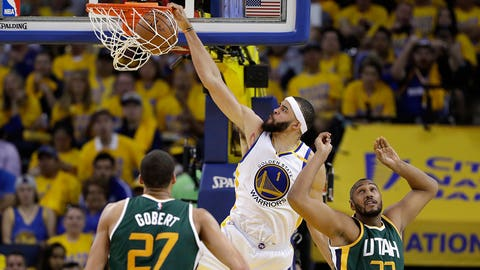 Golden State Warriors' JaVale McGee (1) dunks next to Utah Jazz's Boris Diaw (33) and Rudy Gobert (27) during the second half in Game 1 of an NBA basketball second-round playoff series, Tuesday, May 2, 2017, in Oakland, Calif. The Warriors won 106-94. (AP Photo/Marcio Jose Sanchez)