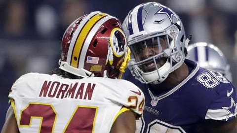 ARLINGTON, TX - NOVEMBER 24:   Dez Bryant #88 of the Dallas Cowboys argues with Josh Norman #24 of the Washington Redskins after catching a pass in their game at AT&T Stadium on November 24, 2016 in Arlington, Texas.  (Photo by Ronald Martinez/Getty Images)