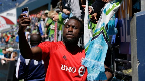 Toronto FC forward Jozy Altidore takes a photo with a fan following an MLS soccer match against the Seattle Sounders, Saturday, May 6, 2017, in Seattle. Toronto FC won 1-0.(AP Photo/Ted S. Warren)